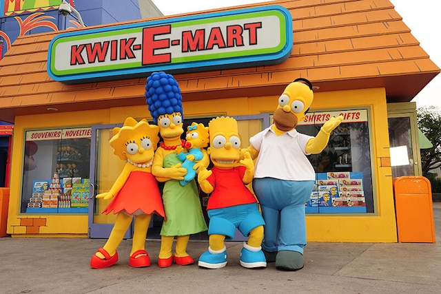 Simpsons taking picture with family