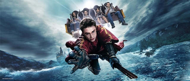 Four kids on the Harry Potter Forbidden Journey ride with Harry Potter flying on a broom.